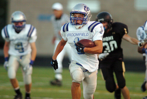 Trent Ireland, Broomfield, runs the ball downfield for a touchdown against Monarch during Friday's game at Centaurus High.  <br /> <br /> September 3, 2010<br /> staff photo/David R. Jennings