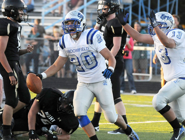 Broomfield's Sean Gentry, center, celebrates making a touchdown against  Monarch during Friday's game at Centaurus High.  <br /> <br /> September 3, 2010<br /> staff photo/David R. Jennings