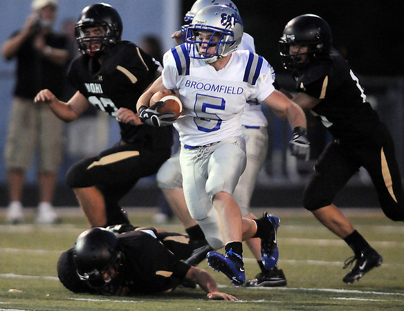 Dan Guebelle, Broomfield, carries the ball downfield against Monarch during Friday's game at Centaurus High.  <br /> <br /> September 3, 2010<br /> staff photo/David R. Jennings