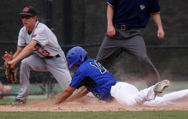 """Broomfield's Hayden Estes,#16, sildes safe into third base before Montrose's Chris Haynes,#3, can tag him out during the Broomfield vs. Montrose baseball game on  May, 18, 2012, Aurora.<br /> Photo by Derek Broussard<br /> For more photos visit  <a href=""""http://www.dailycamera.com"""">http://www.dailycamera.com</a>"""