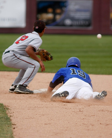 "Broomfield's Brandon Bailey,#19, sildes safe into second base before Montrose's Luis Perez, #12, can tag him out during the Broomfield vs. Montrose baseball game on  May, 18, 2012, Aurora.<br /> Photo by Derek Broussard<br /> For more photos visit  <a href=""http://www.dailycamera.com"">http://www.dailycamera.com</a>"