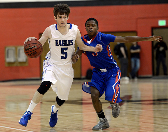 "Broomfield High School's Tarren Macrae dribbles past Trevonne Alexander during a game against Fountain- Fort Carson on Wednesday, Dec. 12, at Fairview High School in Boulder. For more photos of the game go to  <a href=""http://www.dailycamera.com"">http://www.dailycamera.com</a><br /> Jeremy Papasso/ Camera"