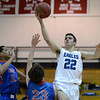 """Broomfield High School's Alec McLain takes a shot over Cameron Hacker, No. 23, and Jordan Rhodes, No. 11, during a game against Fountain- Fort Carson on Wednesday, Dec. 12, at Fairview High School in Boulder. For more photos of the game go to  <a href=""""http://www.dailycamera.com"""">http://www.dailycamera.com</a><br /> Jeremy Papasso/ Camera"""