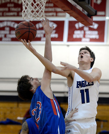 "Broomfield High School's Spenser Reeb takes a shot over Cameron Hacker during a game against Fountain- Fort Carson on Wednesday, Dec. 12, at Fairview High School in Boulder. For more photos of the game go to  <a href=""http://www.dailycamera.com"">http://www.dailycamera.com</a><br /> Jeremy Papasso/ Camera"