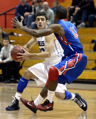 """Broomfield High School's Alec McLain tries to juke Anthony Davis while dribbling the ball during a game against Fountain- Fort Carsonl on Wednesday, Dec. 12, at Fairview High School in Boulder. For more photos of the game go to  <a href=""""http://www.dailycamera.com"""">http://www.dailycamera.com</a><br /> Jeremy Papasso/ Camera"""