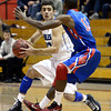 "Broomfield High School's Alec McLain tries to juke Anthony Davis while dribbling the ball during a game against Fountain- Fort Carsonl on Wednesday, Dec. 12, at Fairview High School in Boulder. For more photos of the game go to  <a href=""http://www.dailycamera.com"">http://www.dailycamera.com</a><br /> Jeremy Papasso/ Camera"