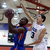 "Broomfield High School's Brandon Hull tries to block the shot of Al Davis during a game against Fountain- Fort Carson on Wednesday, Dec. 12, at Fairview High School in Boulder. For more photos of the game go to  <a href=""http://www.dailycamera.com"">http://www.dailycamera.com</a><br /> Jeremy Papasso/ Camera"