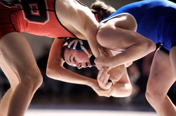 "Broomfield High School's Phil Downing ties up with Pomona High School's Austin Marvel in the 138-pound class during a wrestling match at Broomfield High School on Wednesday, Jan. 25. Downing won the match. For more photos of the matches go to  <a href=""http://www.dailycamera.com"">http://www.dailycamera.com</a><br />  Jeremy Papasso/ Camera"