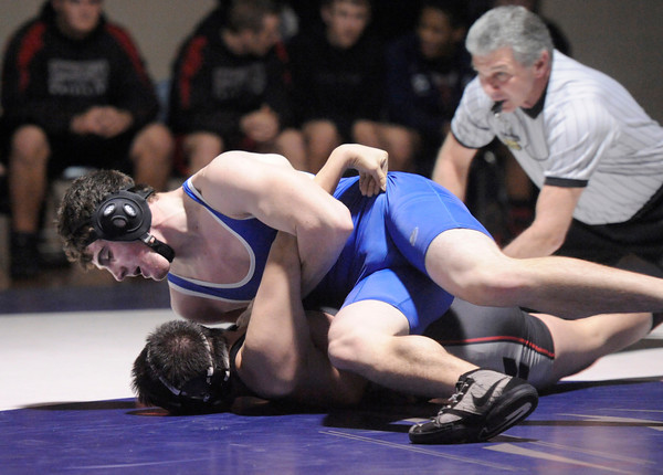 "Broomfield High School's D.J. Zissimos tries to pin Pomona High School's Roman Yslas in the 182-pound class during a wrestling match at Broomfield High School on Wednesday, Jan. 25. Zissimos won the match. For more photos of the matches go to  <a href=""http://www.dailycamera.com"">http://www.dailycamera.com</a><br />  Jeremy Papasso/ Camera"