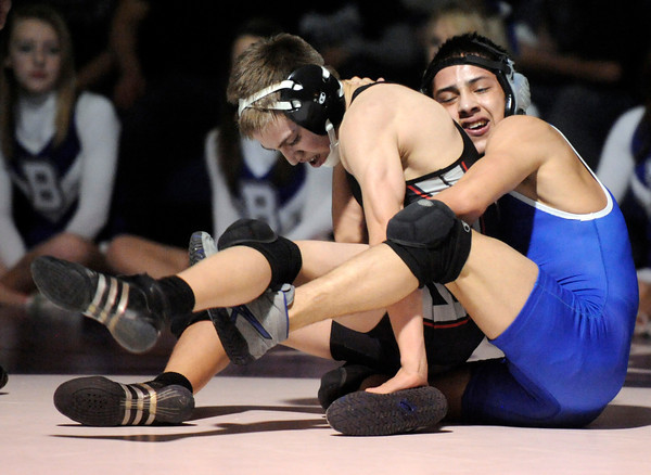 "Broomfield High School's Drew Romero, right, tries to flip Pomona High School's Travis Torres onto his back while wrestling in the 106-pound class during a wrestling match at Broomfield High School on Wednesday, Jan. 25. Romero won the match. For more photos of the matches go to  <a href=""http://www.dailycamera.com"">http://www.dailycamera.com</a><br />  Jeremy Papasso/ Camera"