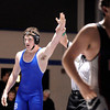 """Broomfield High School's D.J. Zissimos gets his hand help up in victory as Pomona High School's Roman Yslas walks off the mat in the 182-pound class during a wrestling match at Broomfield High School on Wednesday, Jan. 25. For more photos of the matches go to  <a href=""""http://www.dailycamera.com"""">http://www.dailycamera.com</a><br />  Jeremy Papasso/ Camera"""