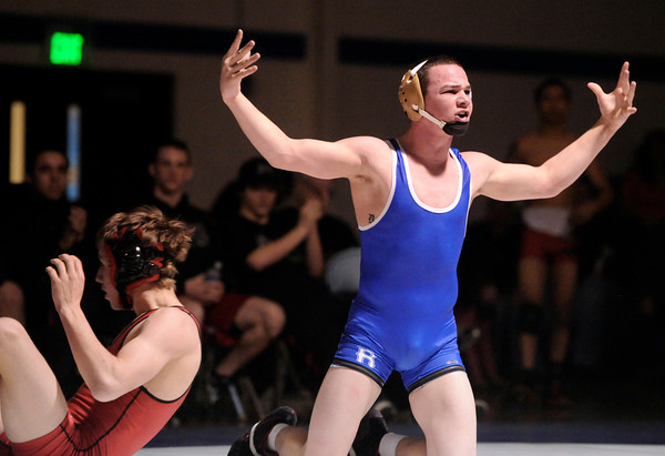 """Broomfield High School's Phil Downing argues a call from the referee while wrestling Pomona High School's Austin Marvel in the 138-pound class during a wrestling match at Broomfield High School on Wednesday, Jan. 25. Downing won the match. For more photos of the matches go to  <a href=""""http://www.dailycamera.com"""">http://www.dailycamera.com</a><br />  Jeremy Papasso/ Camera"""