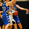 Broomfield's Millie Reeves (left) and Renae Waters (right) box in Silver Creek's Ana Gurau (middle) during their basketball game Silver Creek High School in Longmont, Colorado December 15, 2009.  CAMERA/Mark Leffingwell
