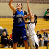 Broomfield's Katie Nehf (left) shoots the ball over the reach of Silver Creek's Ashley Eubanks (right) during their basketball game Silver Creek High School in Longmont, Colorado December 15, 2009.  CAMERA/Mark Leffingwell
