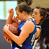 Broomfield's Renae Waters (front) is fouled by Silver Creek's Jacy Drobney (back) during their basketball game Silver Creek High School in Longmont, Colorado December 15, 2009.  CAMERA/Mark Leffingwell
