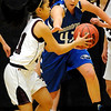 Silver Creek's Alex Hoang (left) steals the ball from Broomfield's Renae Waters (right) during their basketball game Silver Creek High School in Longmont, Colorado December 15, 2009.  CAMERA/Mark Leffingwell