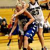 Silver Creek's Jordan Lind (right) pressures Broomfield's Bre Burgesser (left) during their basketball game Silver Creek High School in Longmont, Colorado December 15, 2009.  CAMERA/Mark Leffingwell