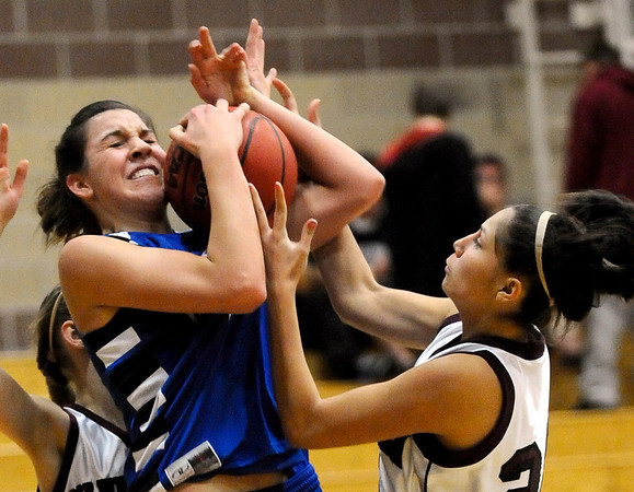 Broomfield's Katie Nehf (left) fights Silver Creek's Amanda Aragon (right) for the ball during their basketball game Silver Creek High School in Longmont, Colorado December 15, 2009.  CAMERA/Mark Leffingwell
