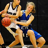 Broomfield's Megan Prins (right) knocks the ball from Silver Creek's Amanda Aragon (left) during their basketball game Silver Creek High School in Longmont, Colorado December 15, 2009.  CAMERA/Mark Leffingwell