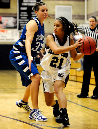Silver Creek's Alex Hoang (right) looks to pass the ball while under pressure from Broomfield's Millie Reeves (left) during their basketball game Silver Creek High School in Longmont, Colorado December 15, 2009.  CAMERA/Mark Leffingwell
