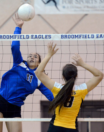 "Broomfield High School's Monro Obenauer goes for a kill over Paige Daniels during a volleyball match against Thompson Valley High School on Tuesday, Oct. 23, in Broomfield. For more photos of the game go to  <a href=""http://www.dailycamera.com"">http://www.dailycamera.com</a><br /> Jeremy Papasso/ Camera"