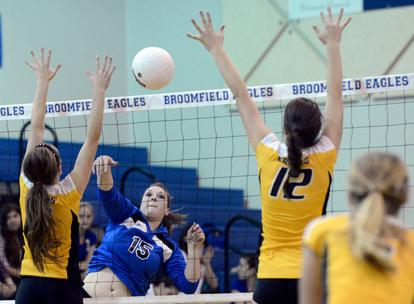 "Broomfield High School's Lindsey Ross goes for a kill over Emily Newton, right, during a volleyball match against Thompson Valley High School on Tuesday, Oct. 23, in Broomfield. For more photos of the game go to  <a href=""http://www.dailycamera.com"">http://www.dailycamera.com</a><br /> Jeremy Papasso/ Camera"