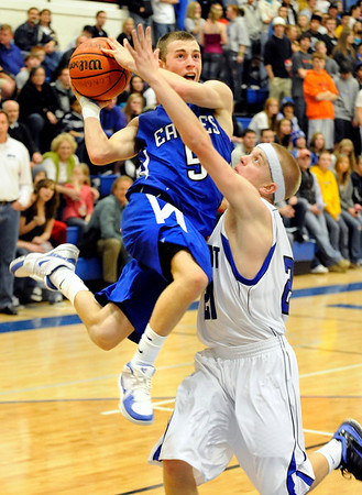 Broomfield junior Austin Wood drives past Longmont senior Isaac Steinbrecher during a basketball game against Longmont High School on Friday, Jan. 14, in Longmont. Broomfield defeated Longmont 68-62.<br /> Photo by Jeremy Papasso