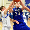 Broomfield senior Dakota Smith gets fouled by a Longmont defender during the basketball game against Longmont High School on Friday, Jan. 14, in Longmont. Broomfield defeated Longmont 68-62.<br /> Photo by Jeremy Papasso