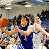 Broomfield High School senior Aric Kaiser shows his skills as he lays the ball up during a basketball game against Longmont High School on Friday, Jan. 14, in Longmont. Broomfield defeated Longmont 68-62.<br /> Photo by Jeremy Papasso