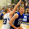 Broomfield High School senior Anders Christianson fights past the defense of Longmont's Nick Chopp during a basketball game against Longmont High School on Friday, Jan. 14, in Longmont. Broomfield defeated Longmont 68-62.<br /> Photo by Jeremy Papasso