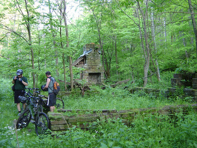 These mountain bikers take a rest on the Brown County State Park mountain bike trail system near Nashville, IN.  This foundation is the remains of a structure built by the park several decades ago.