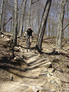 This mountain biker navigates a rocky section of trail on the Walnut Trail in Brown County State Park.