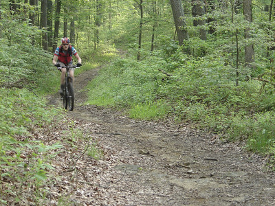 This mountain biker finishes the challenging initial climb on the Nebo Ridge Trail in the Hoosier National Forest near Story, IN.