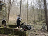 This mountain biker takes a rest on the Brown County State Park mountain bike trail system near Nashville, IN.  This foundation is the remains of a structure built by the park several decades ago.