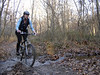 This mountain bike rider splashes through a small creek on a winter ride in Brown County State Park near Nashville, IN.