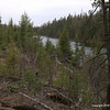 """""""Fire Lake"""".   Circa 1996 a localized fire here burned about two acres of forest.   Now new growth of spruce, balsam, pine and cedar is dotting the landscape.   This was our first proposed site several years ago, but abandoned in favor of Fishook site which is more secluded  from the main trail."""