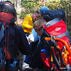 Taking off layers and re-adjusting the packs on the trek into the interior.