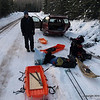 We arrive to Brule Lake road, which is not plowed in winter.  That means we need to pull our sleds for 5 miles.   Here we are assembling our gear onto sleds.
