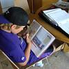 Older brother Trevor doing homework