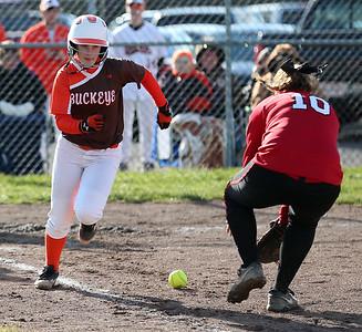 Buckeye's Brianna Matras runs around Firelands' Kaley Blankenship as she fields the ball in the first inning. AARON JOSEFCZYK/GAZETTE