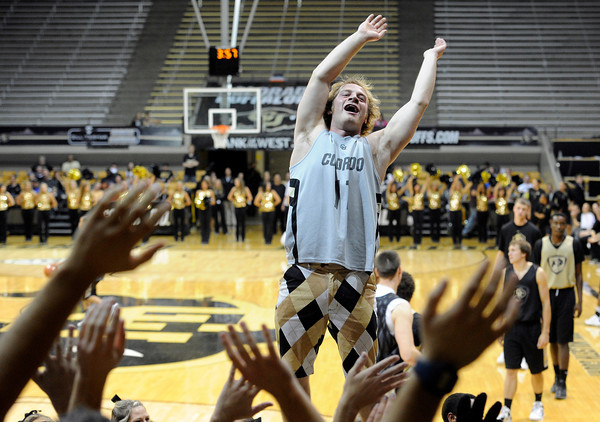 University of Colorado sophomore Griffin Bohm stands on a platform held by cheerleaders as he leads the crowd in a chant during Buff Madness on Friday, Oct. 12, at the Coors Event Center on the CU campus in Boulder. <br /> Jeremy Papasso/ Camera
