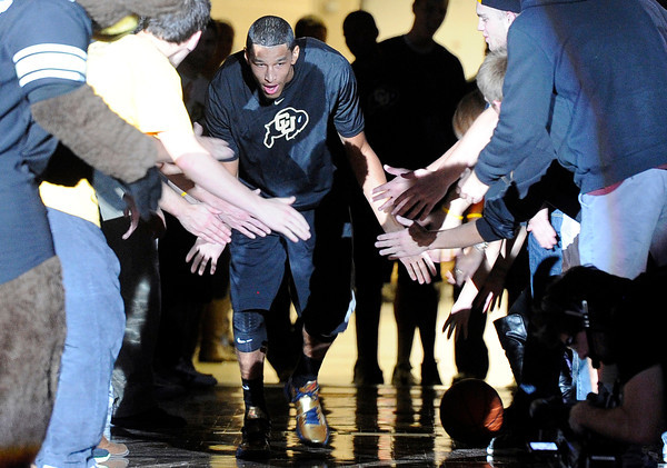 University of Colorado's Andre Roberson slaps hands with fans while being announced during Buff Madness on Friday, Oct. 12, at the Coors Event Center on the CU campus in Boulder. <br /> Jeremy Papasso/ Camera
