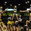 University of Colorado cheerleaders get the crowd riled up during Buff Madness on Friday, Oct. 12, at the Coors Event Center on the CU campus in Boulder. <br /> Jeremy Papasso/ Camera