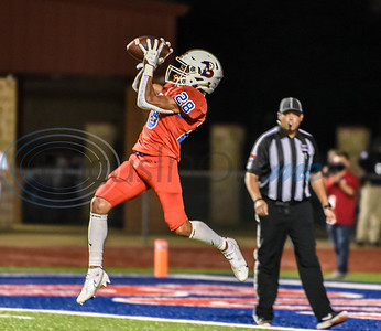 Bullard senior Cameron Baldwin (28) leaps for a catch that turns into Bullard's first touchdown in a game against Rusk on Friday.