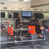 Hélio Castroneves's pole-winning car in the garage