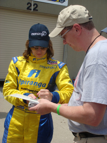 Ana Beatriz signs an autograph for John Becker.