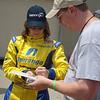 Ana Beatriz signs an autograph for John Becker.