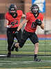 Burleson RB #19 Reece Williams heads upfield while OL #54 Tyler Jones is there to provide blocking. <br /> Burleson High vs Arlington Seguin Football, Sept. 24th, 2021