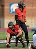 Burleson Center #51 Joel Smith prepares to smap the ball as #1 AB Dylan Raiola takes some off the field direction. <br /> Burleson High vs Arlington Seguin Football, Sept. 24th, 2021