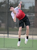 Andrew Cammack serves to his opponent during a match between Burleson Varsity tennis and Burleson Centennial High, Sept. 14, 2021.